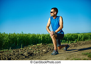 man runner warming up before jogging