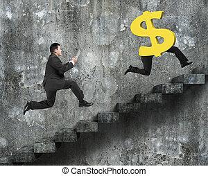 Man running after dollar money symbol