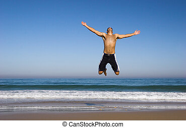 Man running and jumping on the beach