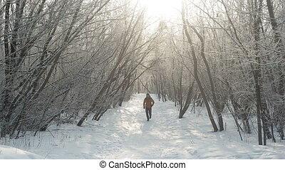 Man running at winter in park