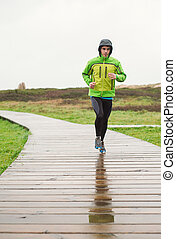 Man running in a rainy day