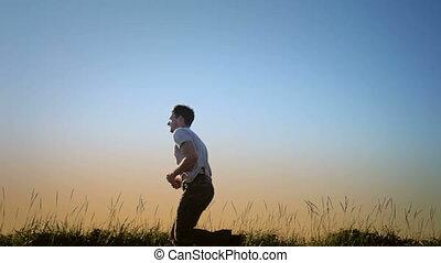 Man Running in Blowing Grass Silhou