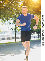 Man running in park at morning. Healthy lifestyle concept