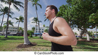 Man running jogging exercising on South Beach Miami Florida...