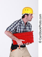 Man running off with tool box