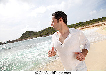 Man running on a sandy beach
