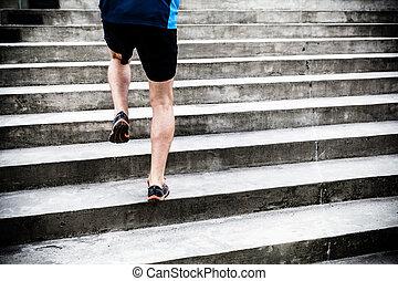 Man running on stairs, sports training - Man runner running...