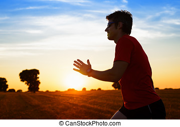 Man running on summer sunset