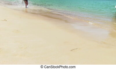 Man running on the summer beach