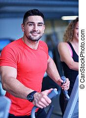 man running on the treadmill - Handsome man running on the...