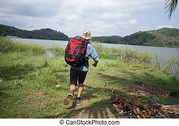 man running while hiking in outdoor