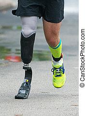 Man running with prosthetic leg on the street.