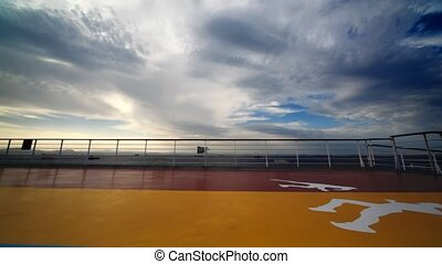 man runs on deck of cruiser in ocean, wide angle - young man...