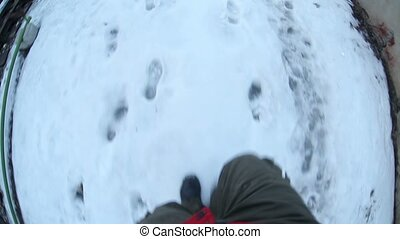 man runs through the snow from the chase first-person video...