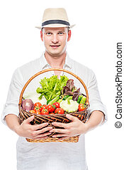 Man rural farmer with a harvest of vegetables on a white background