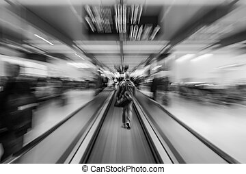 Man rushing to the gate on an escalator in an international airport