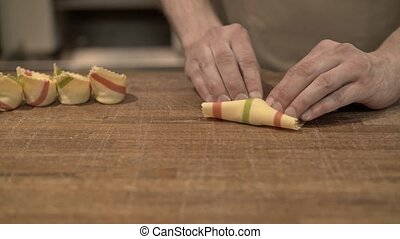 Man s hands making tortellini, a traditional Italian cuisine...