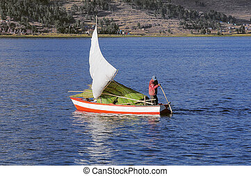 Man sails by boat with cane.