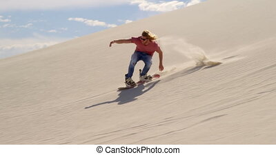 Man sand boarding on the slope in desert 4k - Man sand...