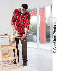 Man Sanding Boards