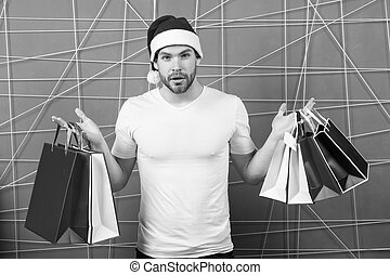 Man santa with shopping bags on pink background