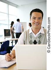 Man sat in open plan office