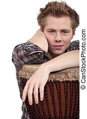 Man sat with bongo drum