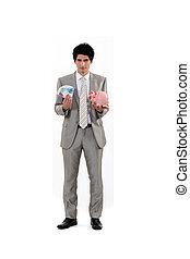 Man saving his money in a piggy bank