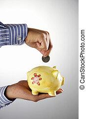 man saving money in the piggy bank