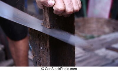 Man Sawing A Piece Of Wood - close up Man Sawing A Piece Of...