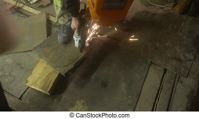 man sawing metal by grinder, working environment - man...