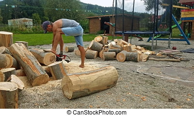 Man sawing wood logs, timelapse