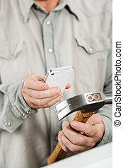 Man Scanning Hammer Through Smartphone