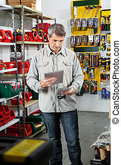 Man Scanning Product Through Tablet Computer