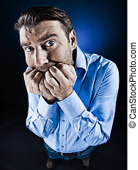 caucasian man scared anxious fear unshaven isolated studio on black backgroun