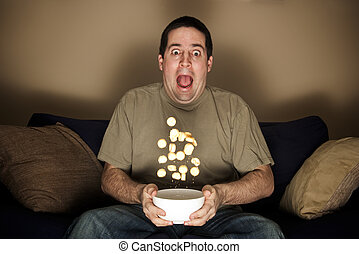 Man scared at horror movie - Man throws crisps frightened...
