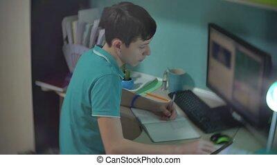 man schoolboy teenager writes does homework . boy schoolboy...