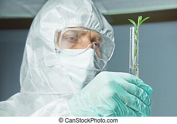 Man scientist with green plant