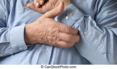 man scratches a rash