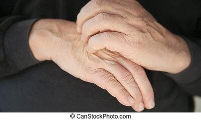 man scratching eczema on hand
