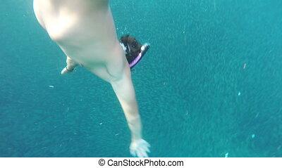 Man scuba diver in tropical sea