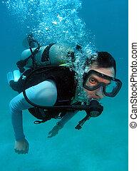 Man Scuba Diving in Great Barrier Reef