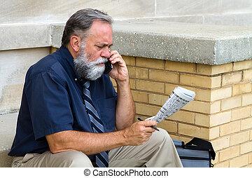 Man Seeking Employment - Mature unemployed salesman makes a...