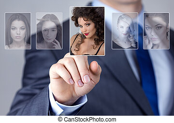 Man selecting a woman portrait image