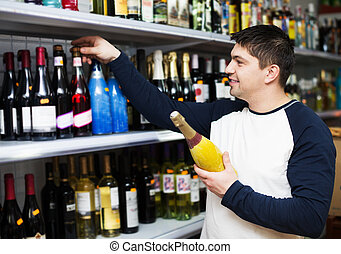 Man selecting bottle of wine