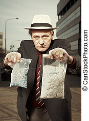 Man selling drugs hidden under suit directly on street