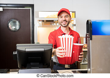 Man selling snacks at the movie theater