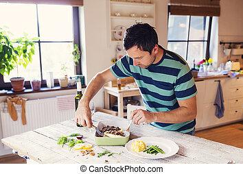 Man serving fish
