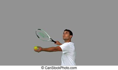 Man serving while playing tennis