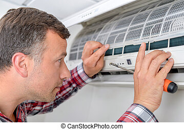 Man setting up an air conditioning unit